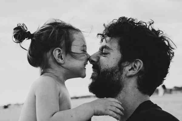 Young girl and father touch noses (hongi). Photo by Caroline Hernandez on Unsplash.